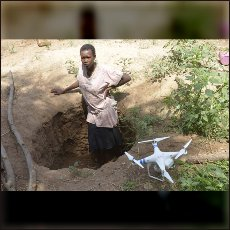 Our drone with Nuba Woman in a tipical fox-hole