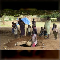 Nuba woman and children diging