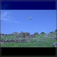 Our quadrocopter above the ruins of an burned village in Nuba Mountains.